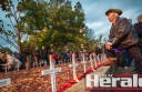 About 4000 people including Colac's Russell Adams attended Colac's Anzac centenary dawn service at the city's Memorial Square. A rain-soaked march down Murray Street followed the service.