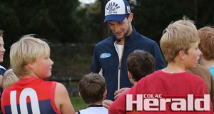 Colac AFL export Darcy Lang, centre, is enjoying a strong start to the season in just his second year at AFL level. He is pictured visiting Otway Districts' under-14.5 footballers at training this month.