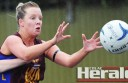 A determined Elle Robertson prepares to grab the ball during Forrest's match against Colac Imperials. The Lions scored 50 goals.