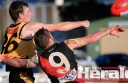 Colac Tigers footballer James Rowan, left, wrestles Newtown and Chilwell star Matt McMahon during the Tigers' narrow loss.