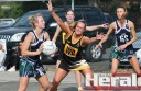 Colac Tigers young-gun Riley Stephens applies pressure on a St Marys netballer during the two sides' drawn contest on Saturday.
