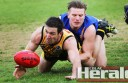 Colac Tigers leader Andrew Kelly fights for the football with North Shore's Jackson Miller. The Tigers had a comfortable win.