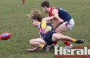 Otway Districts midfielder Luke Comelli and Western Eagles James Beasley fight for the ball. The Demons beat the Eagles by 105 points.