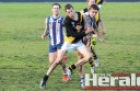 Simpson footballer Brenton de Jong pictured bumping South Colac forward Ben Cox during the clash at Elliminyt.