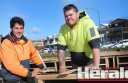 Construction workers Daniel Myyrylainen, Shaun Cross and their team are working on a new platform marking the start of the Great Ocean Road Walk at Apollo Bay.