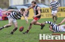 Colac Imperials footballer Joel Jahn and Birregurra's Ryan Connley race for a loose ball during the Saints' hard-fought win.