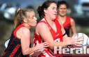 Alvie coach Sara Morrissy, right, takes control of the ball in front of Irrewarra-Beeac netballer Kate Watts during the Swans' three-goal win on Saturday.