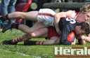 Alvie's Liam Loubey tackles Irrewarra-Beeac's Matt Dunne during the Bombers' 42-point win.