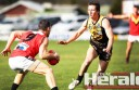 Colac footballer Jack Parker corrals St Josephs star Paul Carson, who booted eight goals in the Tigers' loss on Saturday.