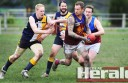Forrest footballer Paul Smith runs away from Western Eagles' Peter Hickey during the Lions' win on Saturday.