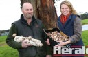 Paul Troughton, left, and his wife Wendy holding their premium shiitake mushrooms. Their company Forrest Foods has grown shiitake mushrooms for five years.