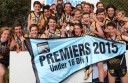 Colac Tigers footballers celebrate their grand final win.