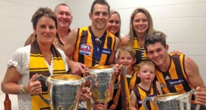 Luke Hodge, centre, celebrated the win in the rooms  with, from left, mother Leanne, father Bryson, sister Bianca McKay, son Cooper, wife Lauren, son Chase and brother Dylan.