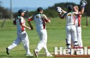 Warrion youngster Mitch Perkins celebrates one of Lokky Harty's two wickets for his new club in its win over Colac on Saturday.