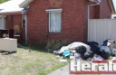 Colac's Queen Street residents have a neighbouring eyesore after an irresponsible Department of Health and Human Services tenant moved interstate and left piles of rubbish and furniture on the front lawn.