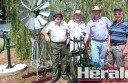 Heritage Festival committee members, from left, Graeme Robb, Geoff Cross, Alan Billing and Graeme Williamson stand with early 1900s water pumps and a model windmill which will be on display at Colac's Heritage Festival on February 6 and 7.