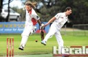 Irrewarra's Bryce McDonald, right, attempts a no-look shot at the wickets to run out Apollo Bay's Virgil Morrow, who made 42 runs.