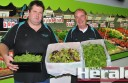 Barlings Fruit Market managing director Joe Barling and employee Tony Maloney show off their fresh lettuce and spinach supplies at the Colac business.