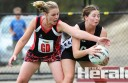 Birregurra's Kirsty Roberts, left, works hard to stop Lorne young gun Mali Gallaher on Saturday.