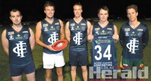The Colac Imperials will celebrate their heritage with a recreated football uniform this weekend, modelled on the jumper that the club wore between 1922 and 1937. Pictured modelling the jumpers are Imps footballers, from left, Kieran Mawson, Kyle Roberts, Tim Miller, and co-coaches James Morgan and Tom McKay.