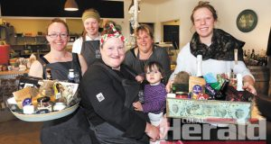 Otway Central's Kassie Williamson, Emma Dwyer, Sue Ladewig and Molly Abraham have organised a fundraiser for Wyelangta's Amy Greene and daughter Lollitta Rose, front centre. Amy has just started chemotherapy after receiving a breast cancer diagnosis last month.